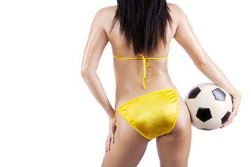 Sexy woman wearing bikini with soccer ball