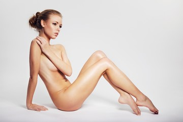Gorgeous naked lady relaxing on floor