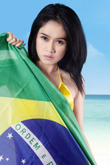 Sexy woman holding brazilian flag