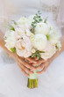 Bride with wedding bouquet, closeup