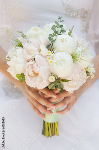 Bride with wedding bouquet, closeup - 66288089