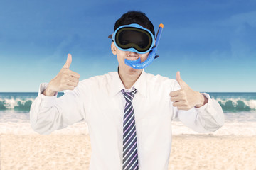 Successful businessman wearing snorkeling tools