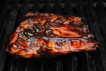 A Saucy Slab of Cooked Baby Back Ribs on the Grill