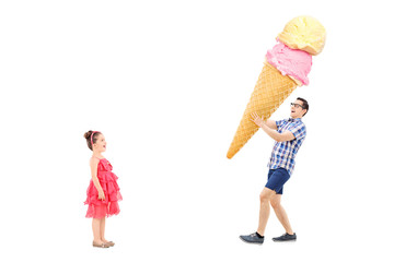 Man bringing huge ice cream to excited girl