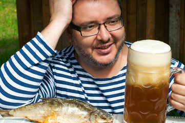 Sailor with beer and fish