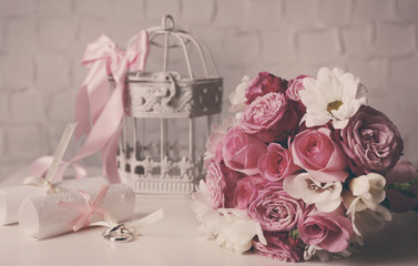 Beautiful wedding still life with bouquet on wall background