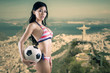 Woman wearing swimsuit with soccer ball 2
