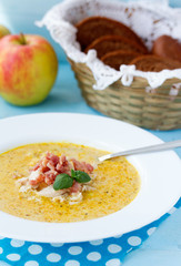 Indian soup with apple, curry, bacon and basil.