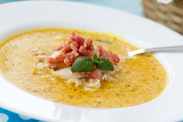 Indian soup with curry, bacon and basil