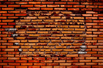 Old and dilapidated red brick wall