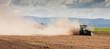Leinwanddruck Bild - Tractor plowing dry farm land