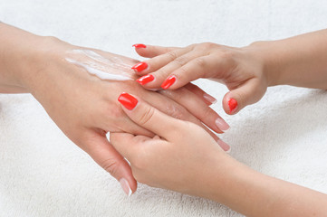 beauty salon, hands massage with moisturizing cream