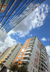 .modern apartments with a blue sky