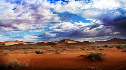 Desert dunes and clouds