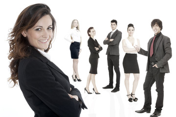 Successful business woman standing with her staff