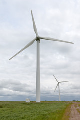 Pair of wind turbines on a wind farm.