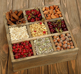 Muesli, nuts and berries in a wooden box