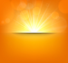 Blurry orange background with lens flare.