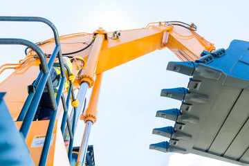 Asian construction worker on shovel excavator