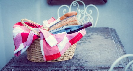Picnic basket of red wine and bread