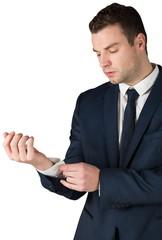 Businessman adjusting his cuffs on shirt