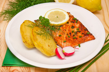 Grilled salmon fillet with boiled potatoes,lemon.