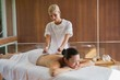 Content brunette enjoying a herbal compress massage