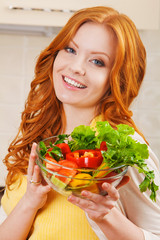 close up portrait of Smiling young woman in the kitchen with