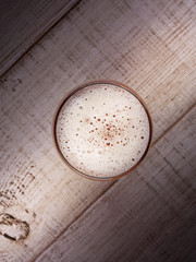 Glass of beer over wooden background
