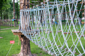 The bridge of logs tied to the ropes, part of a ropes course