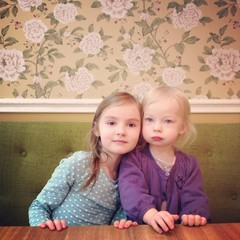 Portrait of two cute little sisters