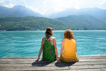 two girls in nature admire the landscape