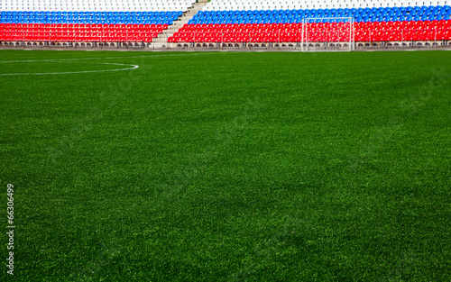 Leinwanddruck Bild football field with stands