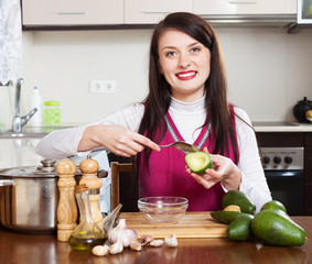 woman cooking with avocado