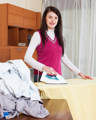 woman ironing with iron
