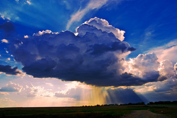 Big cumuli cloud with sun rays