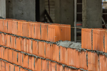 installing clay block wall, lay clay block