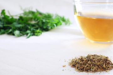 Herbal tea with green herbal leaf  and mixture of dried herbs