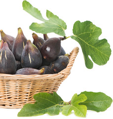 Figs fruits with leaves in a basket