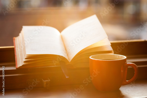 Books and a coffee cup poster