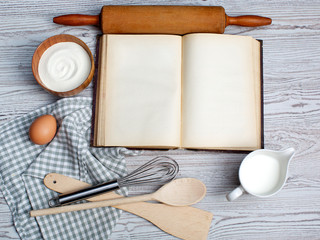 Cooking concept. Ingredients and kitchen tools with the old blan