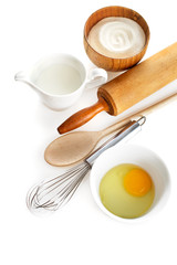 Ingredients and kitchen tools on white background.