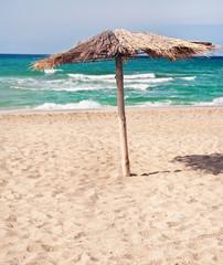 pure tropical sea beach with the  straw beach umbrellas