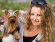 pretty young girl with wavy chic hair and her yorkshire terrier