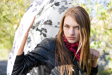 passionate look of attractive girl with umbrella