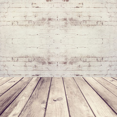 Empty room with wooden floor and white brick wall