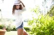 Obrazy na płótnie, fototapety, zdjęcia, fotoobrazy drukowane : Pretty spring woman in the garden