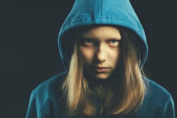 Afraided teen girl in hood