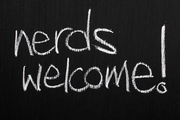 The phrase Nerds Welcome on a blackboard
