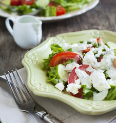 Fresh vegetable salad with feta cheese and tzatziki sauce. Small